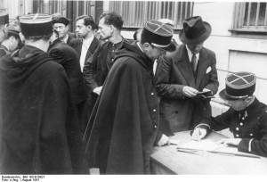 Gendarmes handle identity check and registration of Jews, France 1941 [Attr: Bundesarchiv Bild 183-B10921, wikimedia commons]