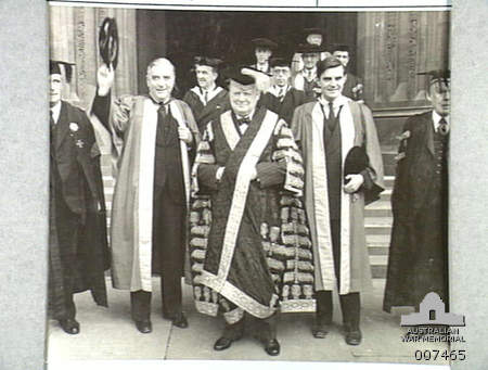 Australian Prime Minister Robert Menzies (waving his cap) and newly appointed United States Ambassador to Britain John Winant receive honorary degrees from Bristol University, where Winston Churchill is Chancellor, Bristol, 1941 [Public domain, Australian War Memorial]