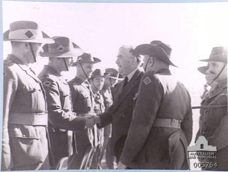 Australian Prime Minister Robert Menzies meets with his country's troops during his 1941 tour of the Middle East [Public domain, Australian National Monument]