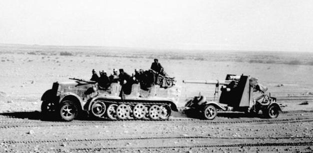 Soldiers of Rommel's Afrika Korps haul one of their 88mm flak/anti-tank guns across the desert, North Africa, 1941 [Bundesarchiv Bild 101l-783-0109-19/ Dorner/ CC-BY-SA, wiki]