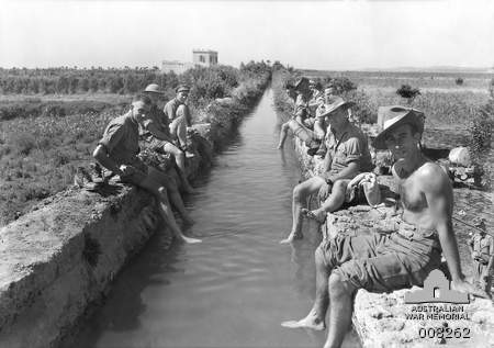 Australian soldiers take a refreshing foot bath in an ancient Roman aqueduct in Syria, June 1941 [Public domain, Australian War Memorial]