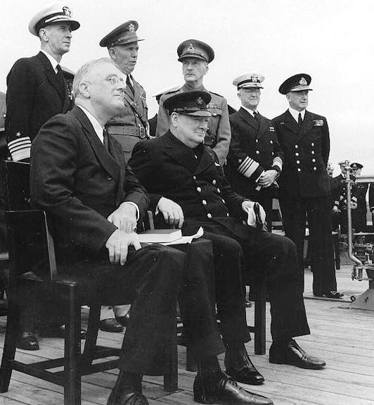 President Roosevelt joins Winston Churchill for a church service on board the Royal Navy battleship HMS Prince of Wales, Newfoundland, August 1941 [Public domain, wiki]