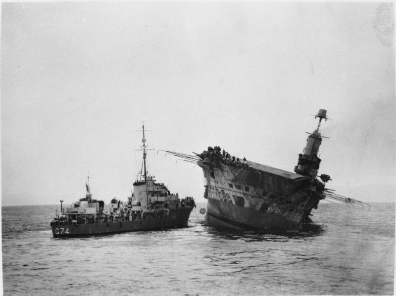 Aircraft carrier HMS Ark Royal, damaged and listing, 13 November 1941. She sank the following day. [Public domain, wiki]