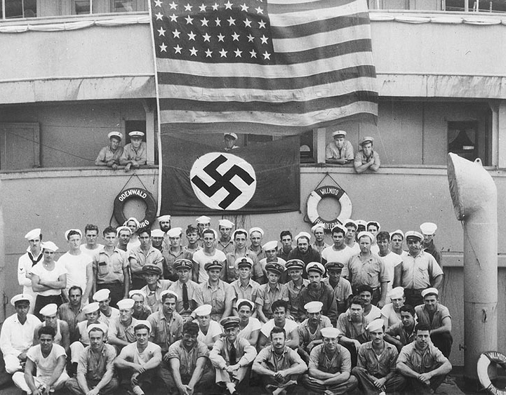 Crew members of the USS Omaha pose on board the captured German blockade runner Odenwald in the South Atlantic, November 1941 [Public domain, wiki]