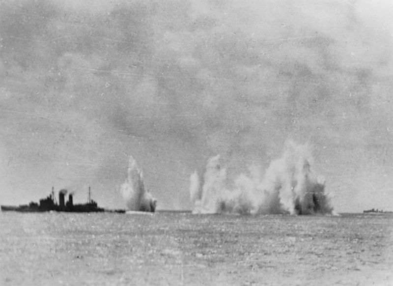 Allied naval squadron under air attack ; Left to right: Cruisers HMS Exeter and HMAS Hobart and a Dutch destroyer, February 1942 [Public domain, wiki/IWM]