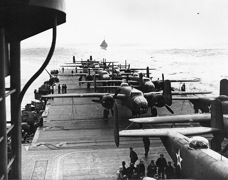 B-25B Mitchell medium bombers on the flight deck of USS Hornet heading towards Japan, April 1942 [Public domain, wiki]