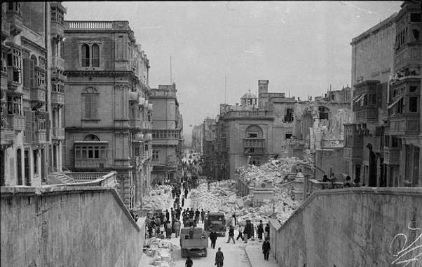 Bomb damage along Kingsway in Valetta. Malta 1942 [Public domain, wiki]