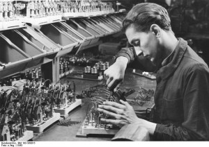 French mechanic working at a Siemens factory in Germany, 1943 [Bundesarchiv, Bild 183-S68015, wiki]
