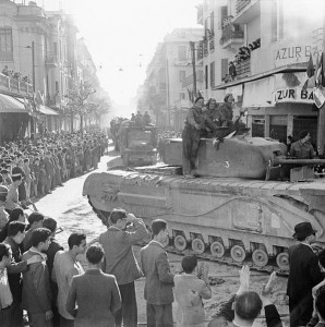 British Churchill tank and other vehicles parade through Tunis, 8 May 1943 [Public domain, IWM]