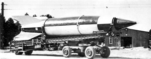 V-2 rocket on its transport trailer [Public domain]