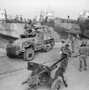 A half-track comes ashore at Reggio during the invasion of Italy, 3 September 1943 [Public domain]