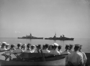 An Italian cruiser and battleship steam slowly past Royal Navy escorting ships en route to Malta to surrender, 10 September 1943 [Public domain]