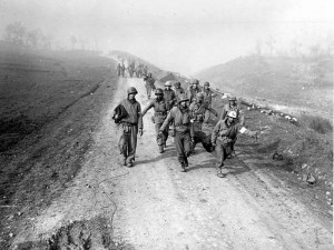US soldiers carry back wounded after an attempted crossing of the Rapido River, Italy 1944 [Public domain]