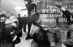 The siege is over: Citizens of Leningrad paint out a sign warning of the danger of enemy artillery; Leningrad 1944 [Public domain]