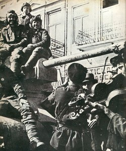 Soviet tank being welcomed in Romania, 1944 [Public domain]
