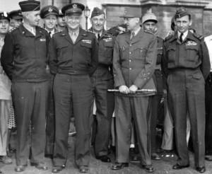 Front row: Generals Omar Bradley, Dwight D. Eisenhower, & Marie-Pierre Koenig, plus Air Marshal Arthur Tedder, taken after D-Day [Public domain]