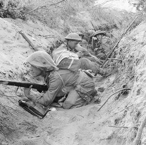 Men of 'D' Company, 1st Battalion, The Green Howards, occupy a captured German communications trench during the offensive at Anzio, 22 May 1944 [Public domain]