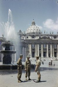 Saint Peter's Square, Rome; two American GIs talk with a British soldier, 1944 [Public domain]