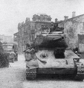 Soviet T34 tank entering Minsk, early July 1944 [Public domain]