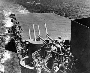 Grumman F6F-3 Hellcat fighter returning to the USS Lexington (Flagship of Task Force 58) June, 1944 [Public domain]