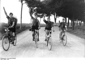Hitler Youth bicyclists give the Hitler salute, 1932 [Bundesarchiv, B 145 Bild-P049482/ CC-BY-SA 3.0]