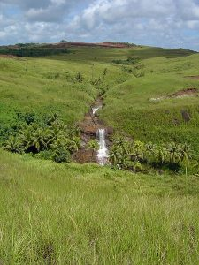 A stream flows down from the highlands of Guam in the Marianas [Author: David Burdick, Public domain]