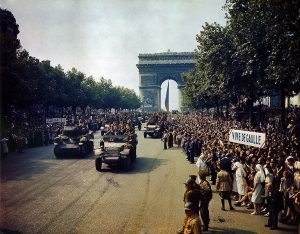Crowds line the Champs Elysees to watch the Free French tanks and halftracks of General Leclerc's 2nd Armoured Division, 25 August 1944 [Public domain]