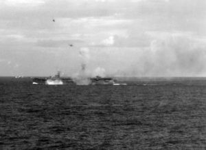 US Navy escort carrier under attack by Japanese aircraft during the Battle of Leyte Gulf, 25 Oct 1944 [Public domain]