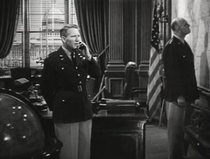 Spencer Tracy (left) as Colonel James Doolittle in the movie Thirty Seconds Over Tokyo [Public domain]